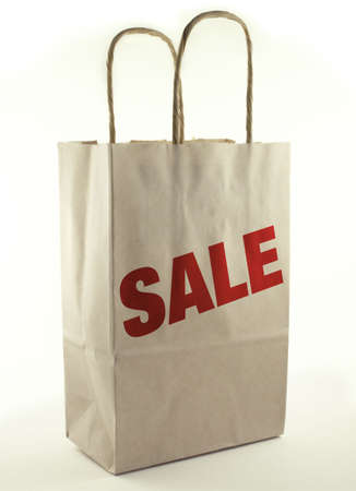 Brown paper shopping bag with Sale.