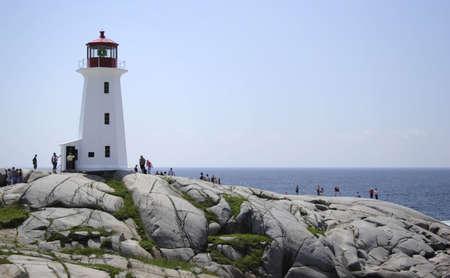 Tourists visiting the lighthouse in Peggys Cove, Nova Scotia. photo