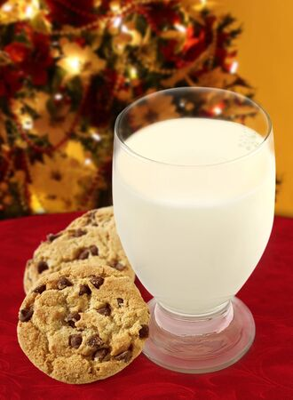 Chocolate Chip Cookies and a glass of Milk on a Christmas background.  photo