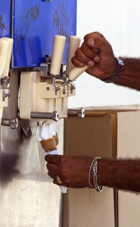 Man filling ice cream cone photo