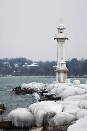 Path to the Geneva lighthouse covered by heavy ice photo
