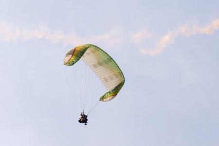 descend: Para glider applying air brakes prior to landing