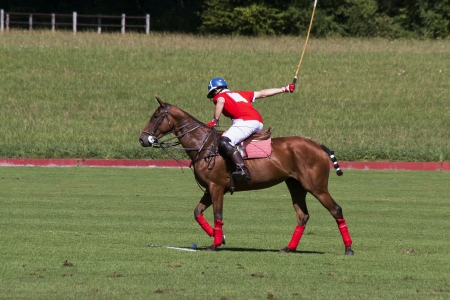 polo: Polo player taking a penalty shot