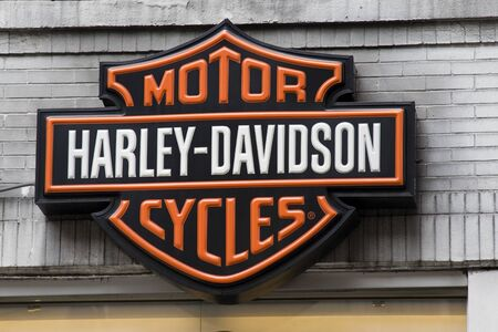 famous industries: New York City, USA, May 30,  2011 - Harley Davidson logo sign hanging above a dealership in New York city.