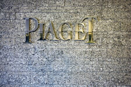 watchmaker: Geneva, Switzerland, April 4, 2011 - Piaget brand logo on a wall.  Piaget is a Swiss luxury watchmaker and jeweller.  The company was founded in 1874 by Georges Piaget in the village of La Côte-aux-Fées. It now belongs to the Swiss Richemont group.