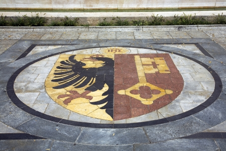 reformation: Coat of arms of the Swiss canton of Geneva embedded on the ground in front of the Reformation wall