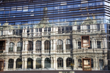 window panes: The Chambre de Commerce building in Lyon reflected in the window panes of the Grand Bazar building