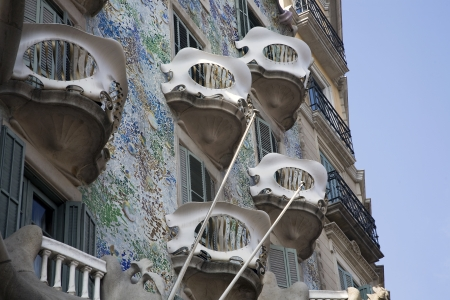 BARCELONA, SPAIN – MARCH 15, 2010: Casa Batllo also known as the Casa dels Ossos (House of Bones) on March 15, 2010 in Barcelona, Spain. The famous building was designed by Antoni Gaudi and is a designated UNESCO World Heritage site.