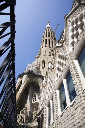 expected: BARCELONA, SPAIN – MARCH 15, 2010: La Sagrada Familia - The Temple Expiatori de la Sagrada Família is a privately-funded Roman Catholic church that has been under construction in Barcelona since 1882 and is not expected to be completed till at least 2026