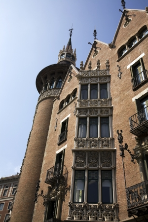 castles needle: BARCELONA, SPAIN � MARCH 15, 2010: Casa Terrades in Barcelona, Spain on March 15, 2010.  This house is also known as the needle houseor the house of spikes because of its towers and sharply pointed gables.  It was designed by Puig i Cadafalch and buil