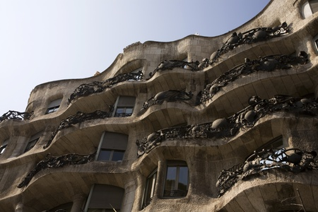 noteworthy: BARCELONA, SPAIN – MARCH 15, 2010: La Pedrera (Casa Mila) designed by the Catalan architect Antoni Gaudí and built during the years 1906–1910 in Barcelona, Spain on March 15, 2010.  La Pedrera  translated as The Quarry because the building walls are des Editorial