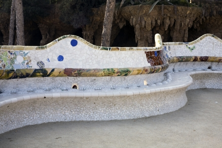 BARCELONA, SPAIN - MARCH 15, 2010: A wavy bench in the famous Park Guell designed by Antoni Gaudi and built during the period between 1900 and 1914 on March 15, 2010 in Barcelona, Spain.  The park is a designated UNESCO World Heritage Site Works of Anton