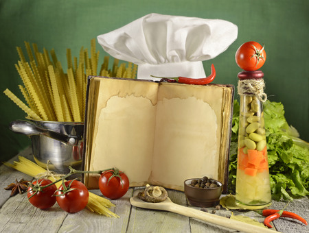 Open cook book with kitchen ware and food Stock Photo - 27875214