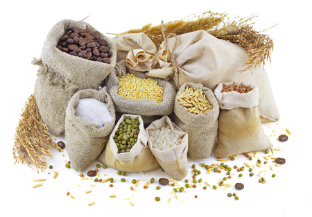 Small burlap bags with cereals, herbs and grain isolated Banque d'images