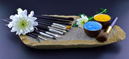 Brush setting with flower on stone photo