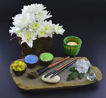 defining: Natural cosmetics set with candle and flowers Stock Photo