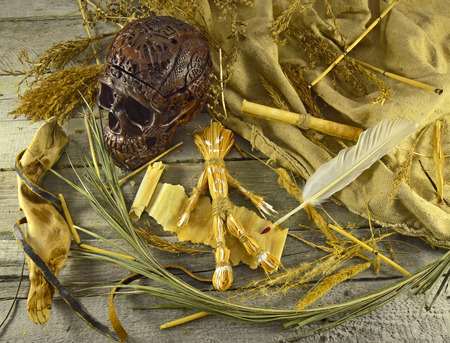 wiccan: Halloween voodoo background with skull, straw doll and quill pen