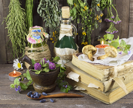homeopathic: Homeopathic still life with healing herbs, books, glassware and candles
