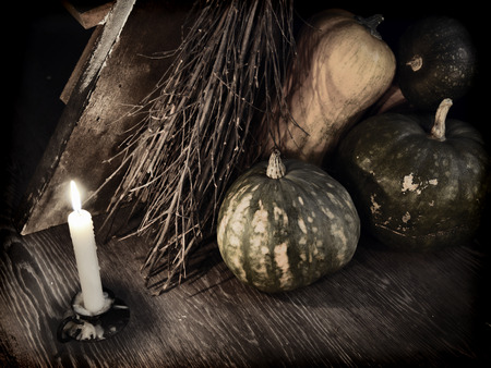 Dark mystic ritual with broom stick, candle and pumpkins by staircase.  Occult or esoteric concept with magic objects, Halloween background Stock Photo