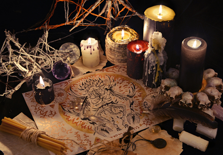 Mystic still life with demon drawing, magic objects and black candles. Halloween concept. Occult objects on table. There is no foreign text in the image, all symbols are imaginary and fantasy ones Archivio Fotografico