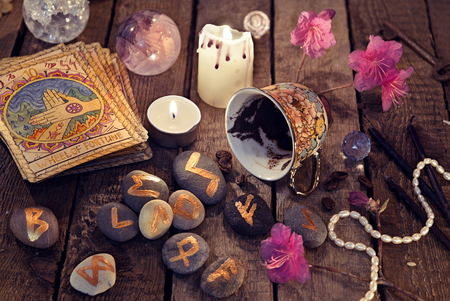 Divination rite with coffee and stone runes. Halloween background, coffee and tarot cards reading ritual, occult and esoteric objects on witch table