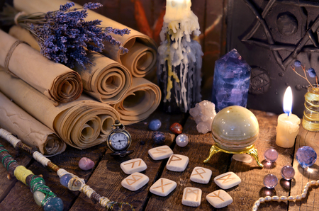 Ancient paper scrolls with runes and magic crystals. Occult, esoteric, divination and wicca concept. Mystic and vintage background