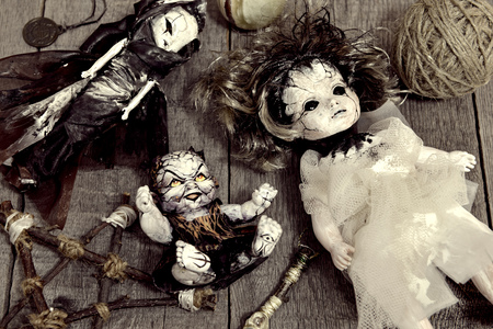 Scary dolls and pentagram on wooden planks. Occult, esoteric, divination and wicca concept. Halloween vintage background