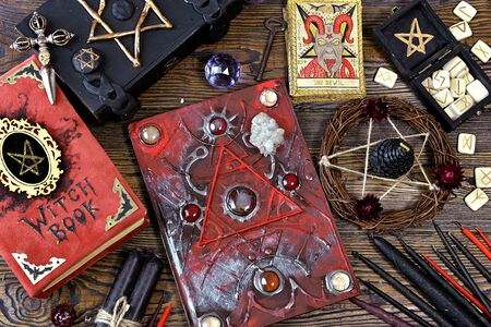 Still life with magical books, tarot cards and candles on witch altar table. Esoteric, gothic and occult concept, Halloween mystic background, divination ritual Stok Fotoğraf