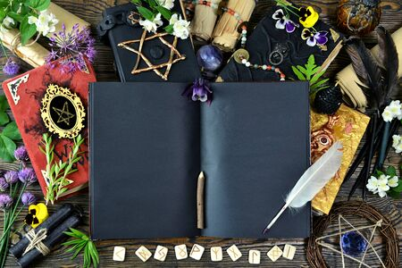 Still life with open diary, quill, witch book, herbs and magical objects on table, top view. Esoteric, gothic and occult concept, Halloween mystic background, divination ritual Stok Fotoğraf