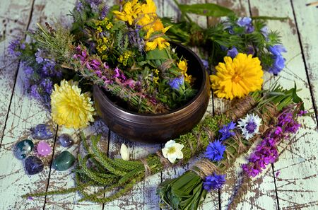 Bowl with herbs, plants and flowers on witch table.  Esoteric, occult and mystic concept, alternative medicine background with natural healing ingredients. 스톡 콘텐츠