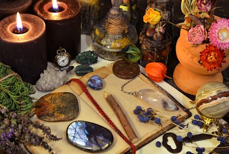 Still life with magic objects, open diary, gemstone, crystall ball and burning candle on witch table. Esoteric, wicca and occult background, fortune telling and divination ritual, mystic concept Foto de archivo - 137412055