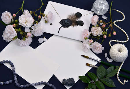 Still life with decorated envelope, paper sheets, roses and crystal on table. Mystic and romantic background with copy space and blank, vintage romantic concept for mock up, top view
