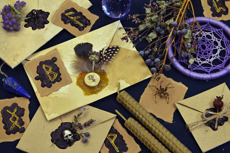 Still life with runes, spider, decorated envelopes and magic objects. Mystic and romantic background with copy space and blank, vintage romantic concept for mock up, top view