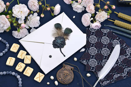 Tarot cards, runes and magic objects on witch table.  Mystic and romantic background with copy space and blank, vintage romantic concept for mock up, top view