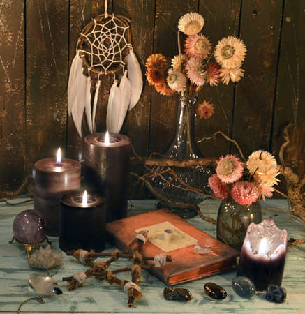 Still life with diary book, black candles, dreamcatcher and dry flowers. Esoteric, gothic and occult background, Halloween mystic concept.