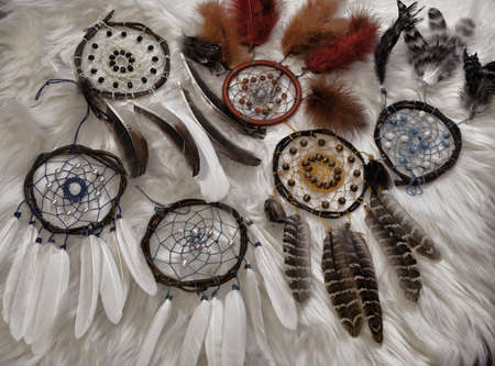 Beautiful boho styled dreamcatchers with feathers.  Esoteric, gothic and occult background.