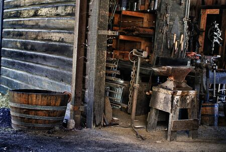 ancient blacksmith: old black smith`s shop in a museum of an old town