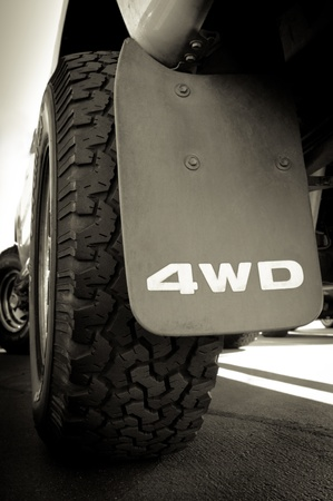 off track: 4WD sign and tire of a big truck Stock Photo