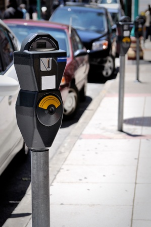 a parking meter on the line of meers