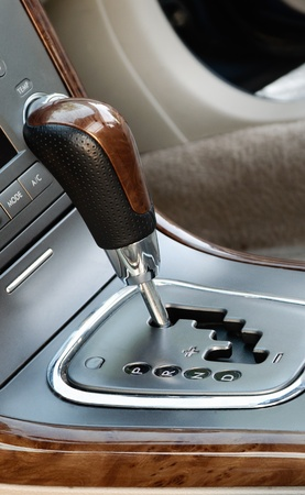 luxurious interior: close up view of car gearshift and details