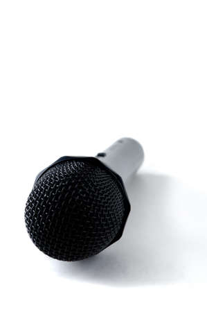 portrait orientation: Professional Microphone with a shadow Isolated on white, portrait orientation
