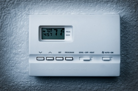 vignetting: air conditioning control panel on a wall, blue Vignetting