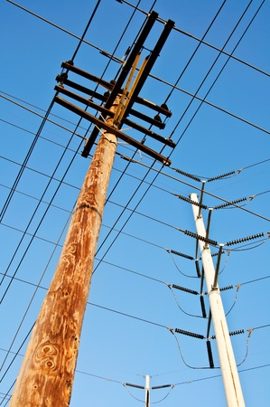 wooden utility pole with power lines with blue sky background Stock fotó