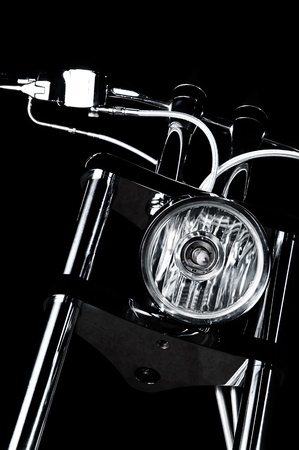 Close-up view on chrome headlight and handlebars of luxury bikeme chopper handlebars