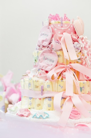 Diaper cake with a multi leveled diaper cake for a baby shower, soft high key
