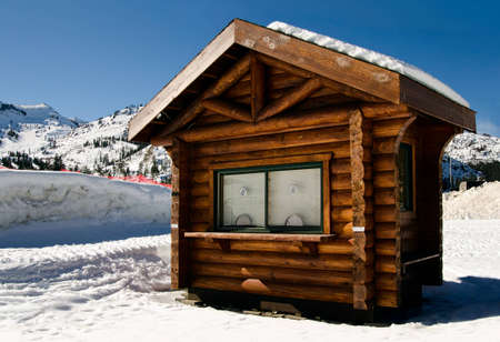 wooden house: Wooden shack in the snow, under blue sky