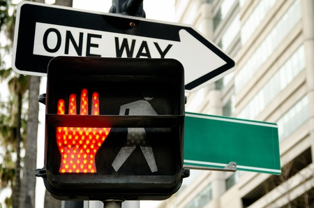 pedestrian traffic light indicating red hand and empty street sign Фото со стока