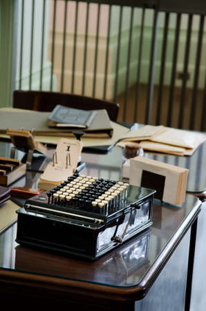 a vintage Adding Machine on a table in office table