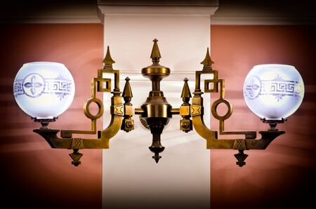 an antique electric lamp on a wall Stock Photo - 13094126