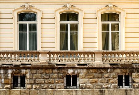 facade of building and three big old windows Stock Photo - 13295777